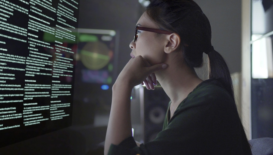 woman in technology looking at screen