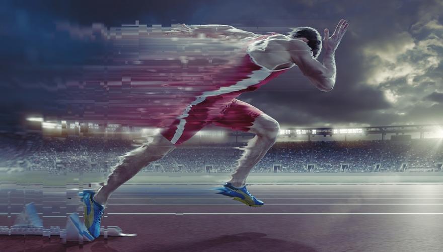 Athlete running fast on track