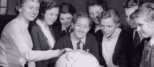 Children looking at a globe: How to localise your content without losing your voice
