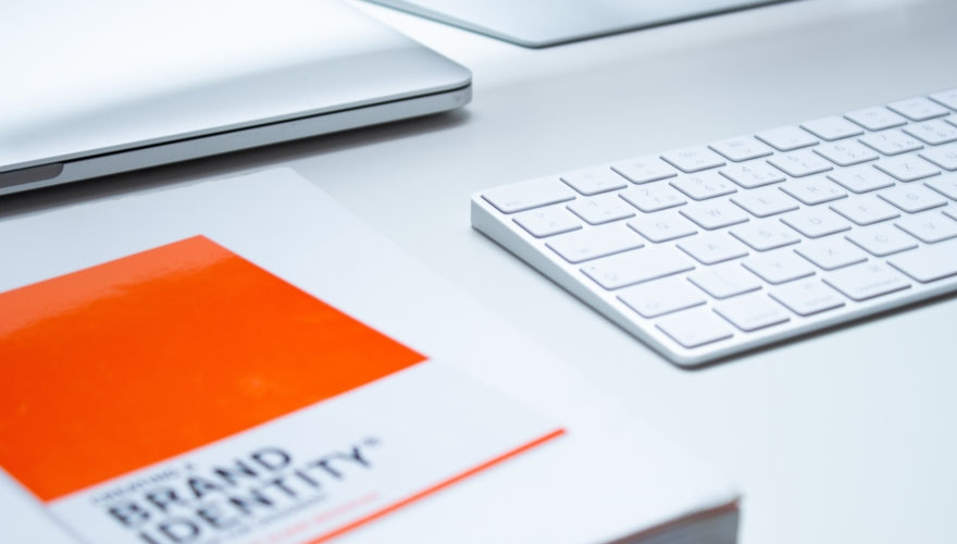brand identity notebook beside laptop