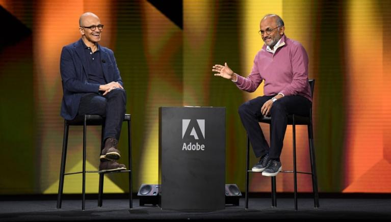 Microsoft CEO Satya Nadella and Adobe CEO Shantanu Narayen on stage at the Adobe Summit 2019